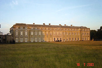 Petworth House, Sussex, one of the many country houses which hosted a production in aid of charity (July 2003).  Part of the audience is visible refreshing itself before the performance.